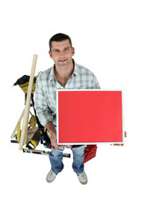 Carpenter posing with a picture frame