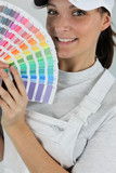 female painter holding a color chart