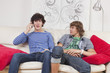 relaxed teenagers on the phone at home