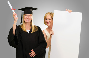 Woman Presenting Placard Infront On Graduate Student