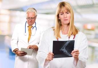 Portrait Of Two Busy Doctors