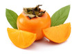 Slice persimmons with green leaves