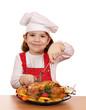 little girl cook cutting roast chicken