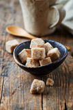 Brown sugar cubes in a ceramic dish