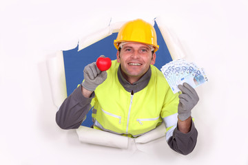A construction worker showing his cash.