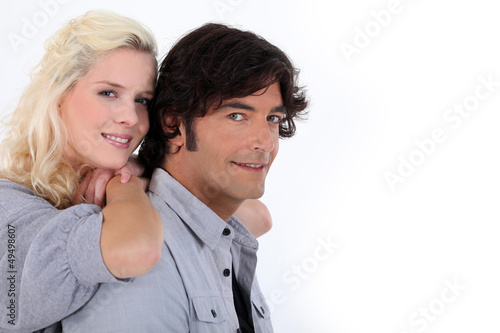Couple stood together on white background