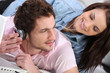 Couple listening to music together