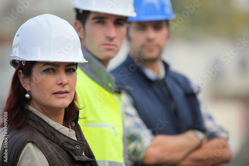 Three construction colleagues
