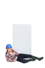 craftswoman lying in front of a blank poster