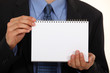 Man holding blank note pad