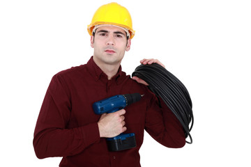An electrician holding a drill.