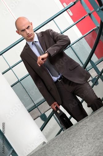 A businessman climbing stairs to his appointment.