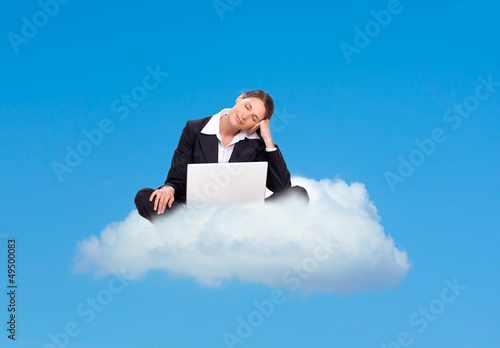 Business woman dreaming on a cloud