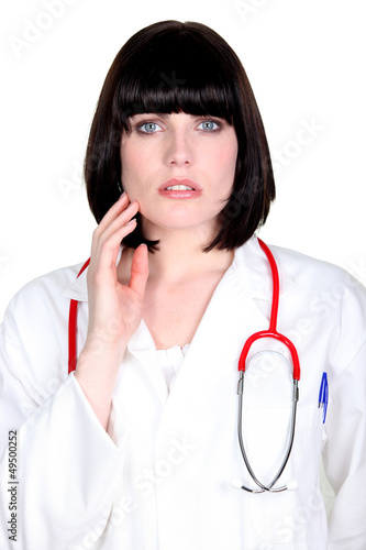 Female doctor worried