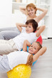 Kids with their mother doing gymnastic exercises