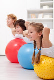 Fototapety Happy healthy kids exercising