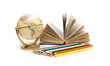book, globe and pencils of different colors on a white backgroun