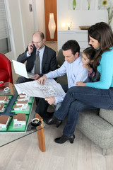 Architect sat with young family