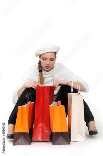 elegant woman looking in her shopping bags