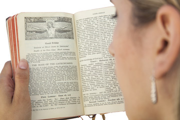 woman reading catholic missal