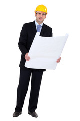 businessman holding a blueprint