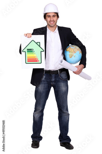Man with globe and energy panel