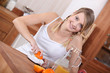 Girl squeezing orange juice