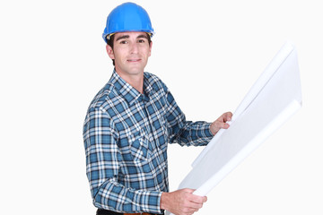 Laborer looking over plans
