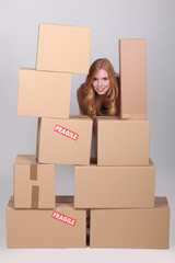woman stood by pile of cardboard boxes