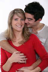Couple hugging in studio
