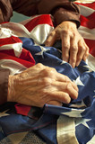 Hands on an American flag