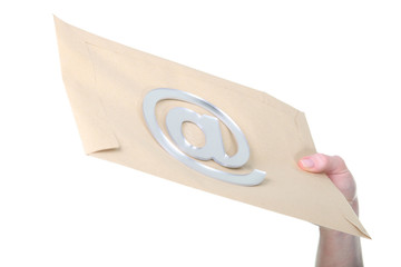 Concept shot of email: an @ sign on an envelope