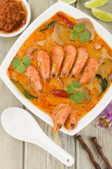 Tom Yum Nam Khon - Creamy Thai soup with prawns and mushrooms.