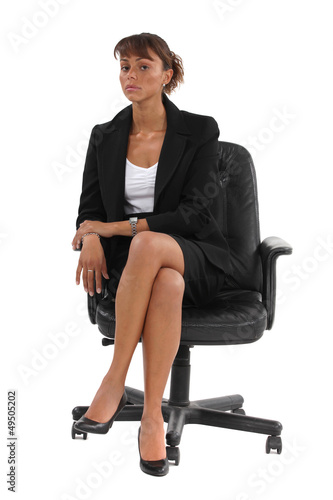 Businessman sat in chair waiting