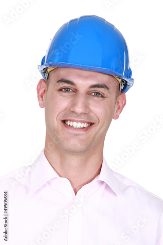 Smiling man wearing a hardhat