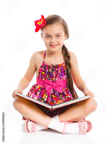 Happy little girl with book