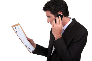 businessman on the phone discussing with partners