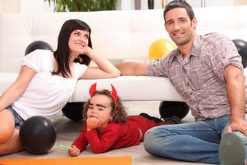 Parents with children dressed as devil