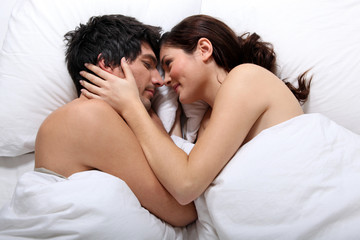 Naked couple in bed