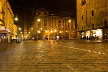 view of via Rizolli and tower in Bologna at night