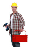 Man with a toolbox and powerdrill