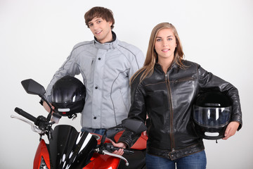 Couple stood with motorbike