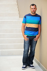 Full length portrait of young adult man