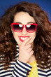 Beautiful happy young woman wearing sunglasses