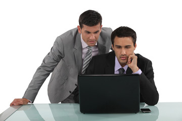 Business partners reading an e-mail together