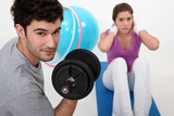 Couple exercising at the gym together