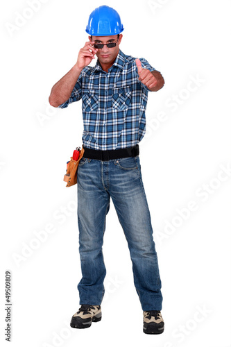 Confident construction worker on white background