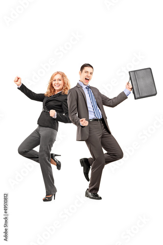Full length portrait of a happy businesspeople gesturing happine