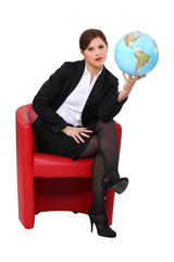 A woman holding a globe.