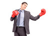 Young businessman posing with red boxing gloves